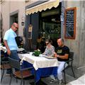 Stefano - Outdoor dining with friends/clients under the Tuscan Sun (Cortona)